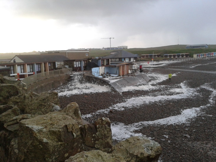 2014-02-02-08.45.50 Storm damage at Crooklets Bude after high tide last night. More beach huts lost!