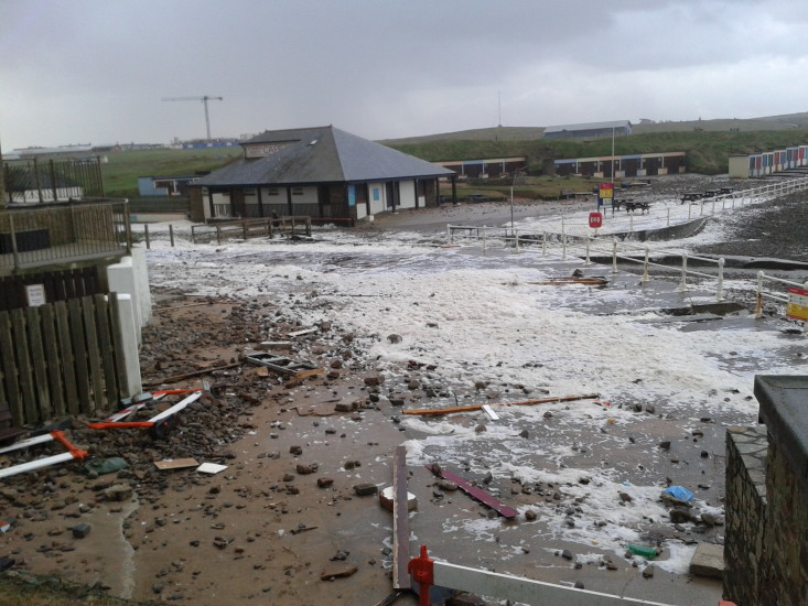 2014-02-02-08.47.33 Storm damage at Crooklets Bude after high tide last night. More beach huts lost!